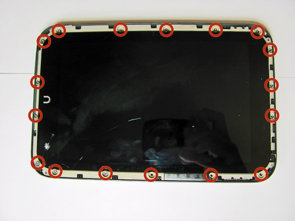 Use a T5 screwdriver to remove the seventeen 5.0 millimeter screws from the back casing.