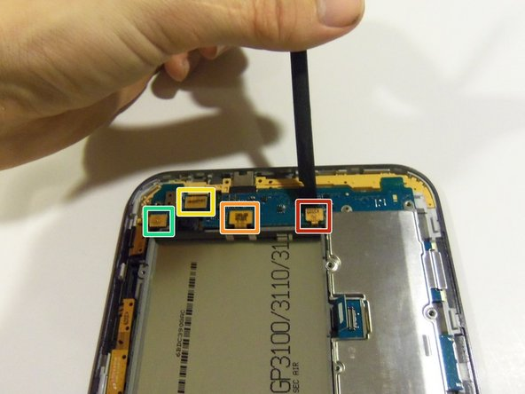 Image 1/2: Using the plastic pry tool release the sensor flex cable from its socket.