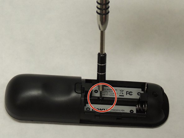 Use a Phillips #00 screwdriver to remove the 1.5 mm wide screw.