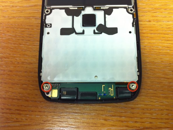 Image 1/2: Unscrewed the 2 screws on the bottom edge of the phone, this time T6 torx.