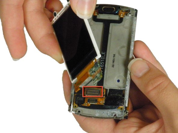 Use the spudger to pry the ribbon cable directly up from its clip on the metal casing.