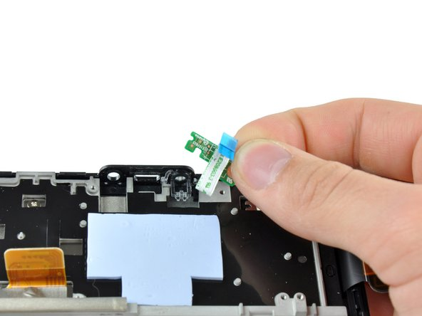 Lift the power button board out of the Kindle Fire.