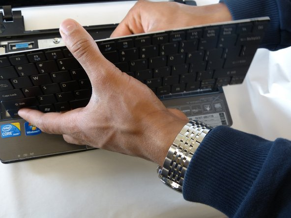 There is a plastic film that needs to be gently peeled from the laptop base.