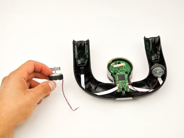 The rumble motors will easily  lift out of the controller once the wires are detached.
