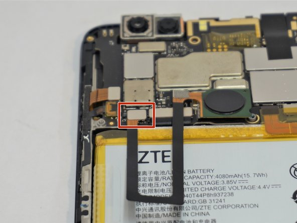 Using a plastic opening tool, separate the fingerprint ribbon connector from the motherboard.