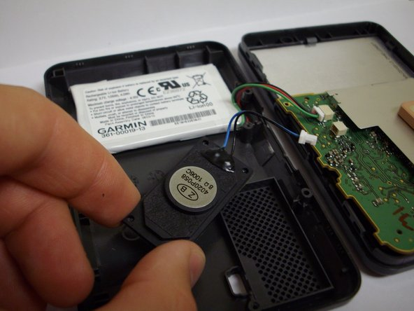Using a plastic opening tool, wedge the speaker away from the device.  The speaker is glued to the case so use force and leverage.