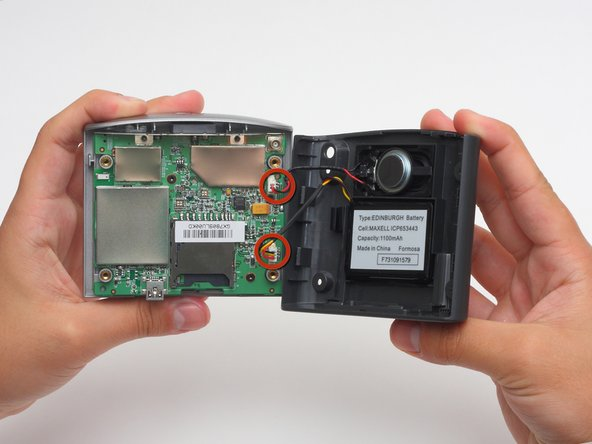 Carefully pull the back cover apart from the front cover. Be careful not to pull too hard because there are two sets of wires connecting the device.