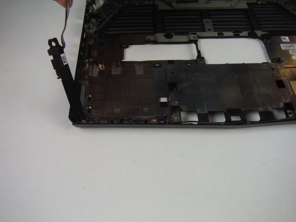 After removing the battery, lift up on the speakers and wires to fully removed from the base panel.