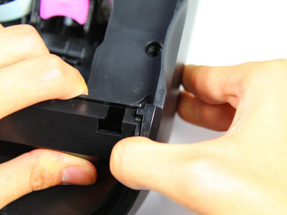 Detach the right-side panel by pulling the right-side cover clip away from the internal protective cover.