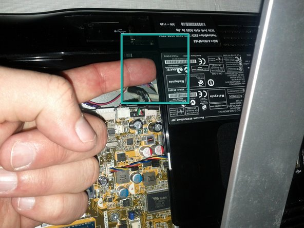 Put your finger under the plastic panel and left up with your finger. The panel should put up a bit, then do the same thing on the other side.