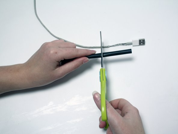 While cutting, keep the length of the heat shrink longer than the length of the frayed or damaged area.