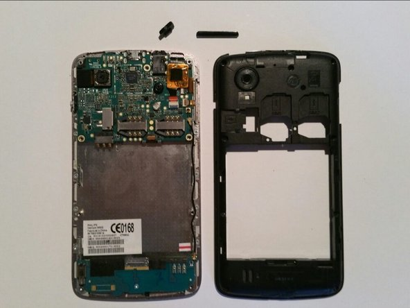 Gently lift the back cover away from the phone. Do not worry if the buttons fall out, you can easily put them back later.