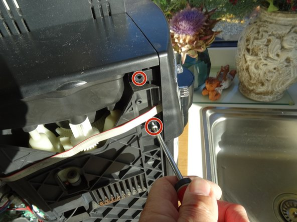 Use a plastic opening tool to lever off the steam tap.
