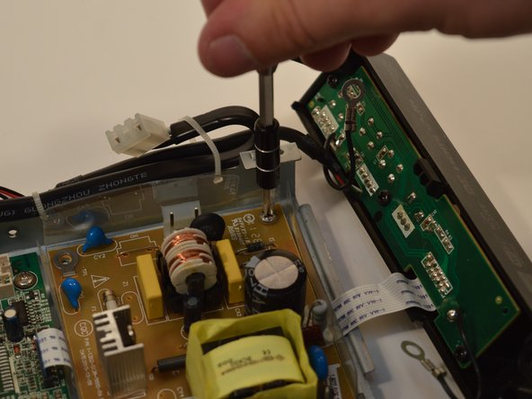 Remove the 4 screws holding the power board the the body of the device.