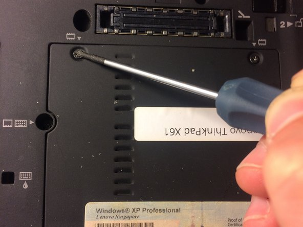 Next, locate where the two Philip #00  screws are marked in the image, and unscrew them as shown.