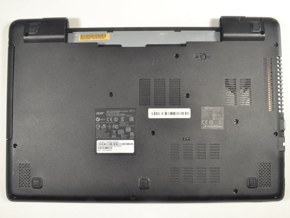 Rotate the laptop 180 degrees so that the battery compartment is now furthest away from your body.