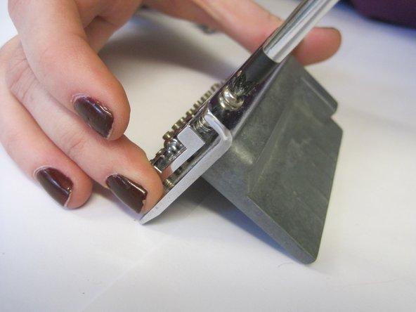 Unscrew chrome parts.