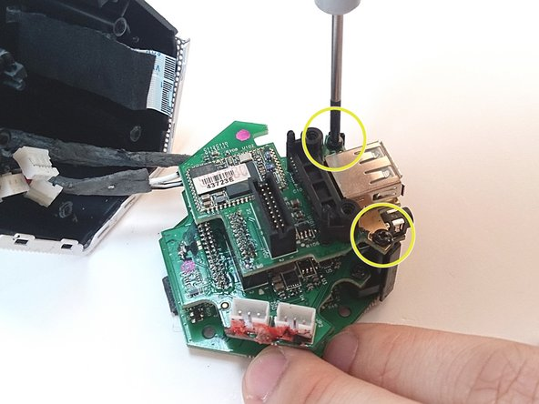 The next PCB in the stack houses the USB port for smart device charging.