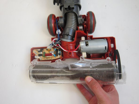 Gently lift casing to remove belt and brush from vacuum.