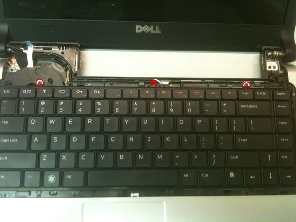 Remove two small (2x3mm) screws securing the keyboard to the casing.