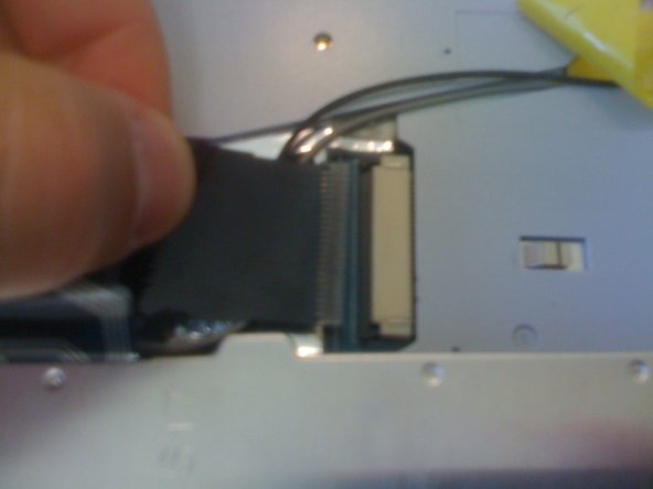 Image 3/3: The keyboard is now completely disconnected from the laptop.