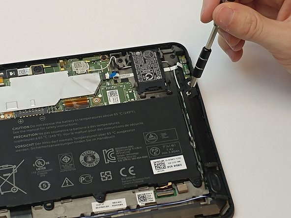 Using aJIS #00 screwdriver locate and remove the two 3.5mm screws by the plastic covers on left and right side of the tablet
