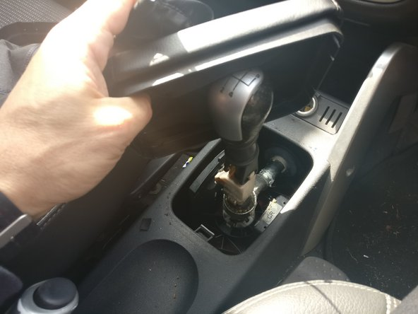 Pull the gaiter up over the gear knob