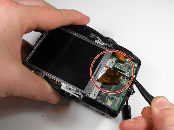 Use the tweezers to carefully detach the screen's flex ribbon from the circuit board.