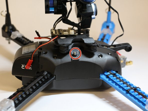 Unscrew the 16 mm  screw attaching the gimbal mount to the body of the drone using the 3 mm Hex screwdriver/key.