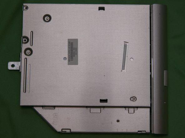 Remove the optical drive, if all the screws have been removed is should slide out easily.