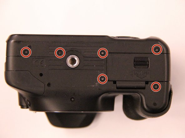 Remove the 7 screws from the bottom of the camera using a Phillips screwdriver