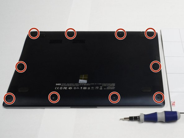 Image 1/3: Carefully remove the bottom case of the laptop to reveal the damaged speakers.