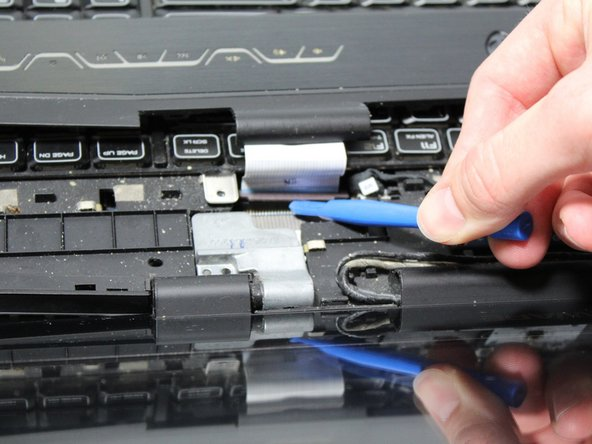 Gently remove the power cable with your hands or with the help of a prying tool.