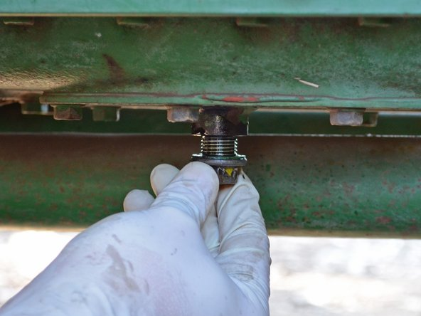 Image 2/3: Use a 17 mm box end wrench to tighten the drain plug until it is snug.