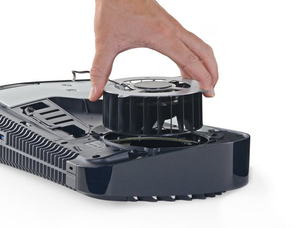 As alien as this console looks, the opening procedure is actually quite human-friendly. Both white panels pop off with a gentle lift-and-slide motion—allowing immediate access to the M.2 SSD expansion slot, the fan, and... vacuumable dust ports.