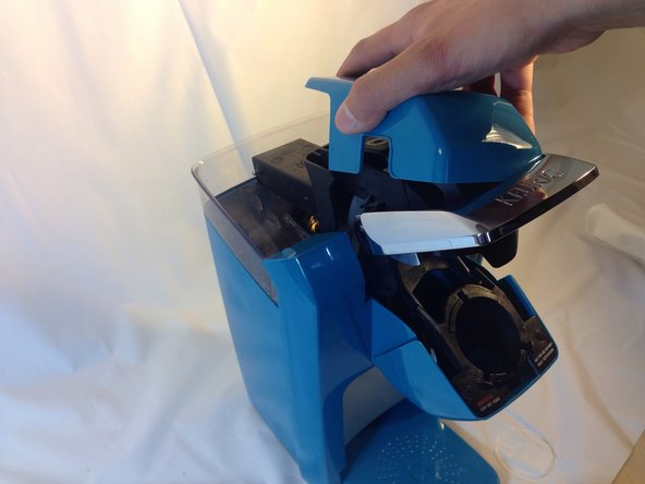 Image 1/1: Pull the cover off the top of the Keurig. It should come off easily with little force.