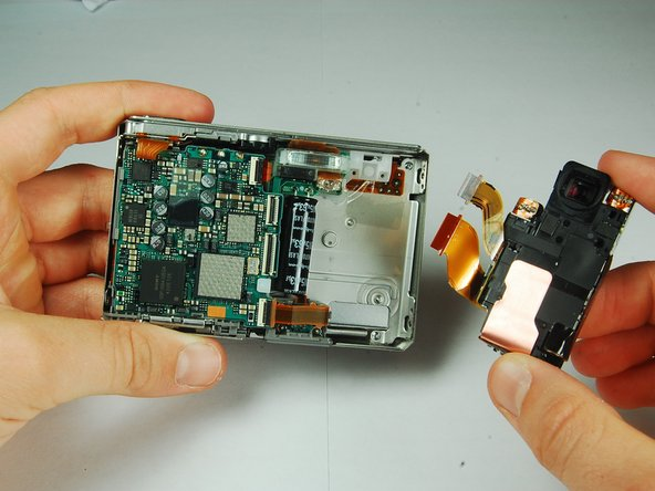Grasp the CCD Sensor Module and remove it.