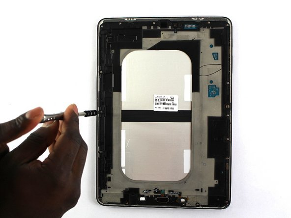 Remove the two 2.74 mm black screws in the middle of the tablet with the Philips #000 screwdriver.