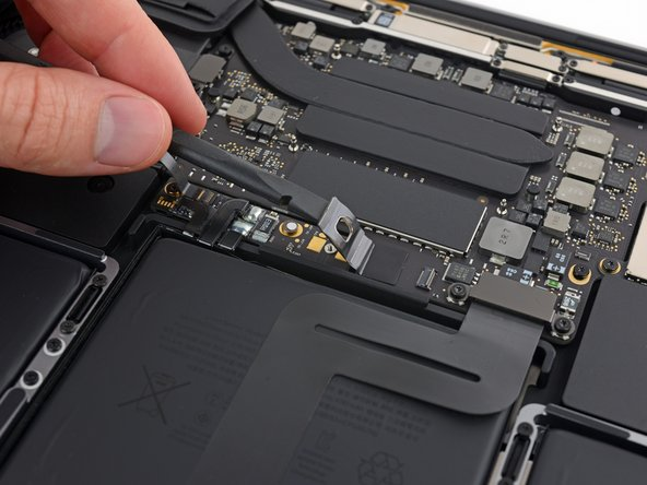 Lift the connector high enough so that it stays separated from its socket. If it accidentally makes contact during the course of your repair, it could damage your MacBook Pro.