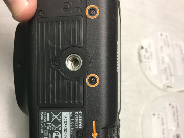 Turn the camera so the bottom is now on top and take out the three screws holding on the bottom of the back plate.