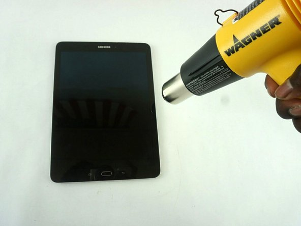Apply the heat gun around the edges of the tablet to melt the adhesive glue.