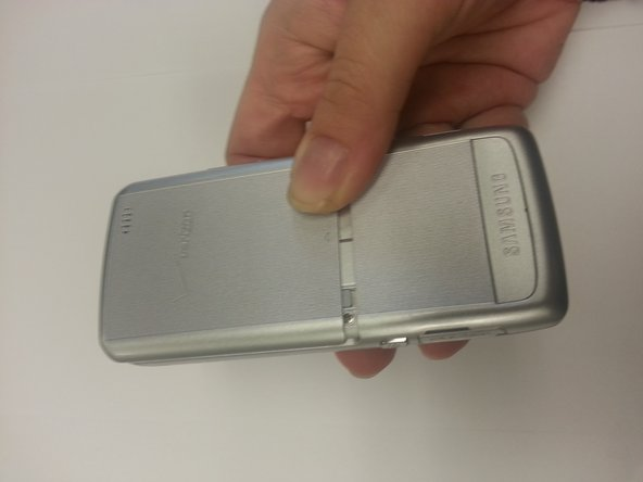 Using your thumb(s) slide the battery cover up to remove it.