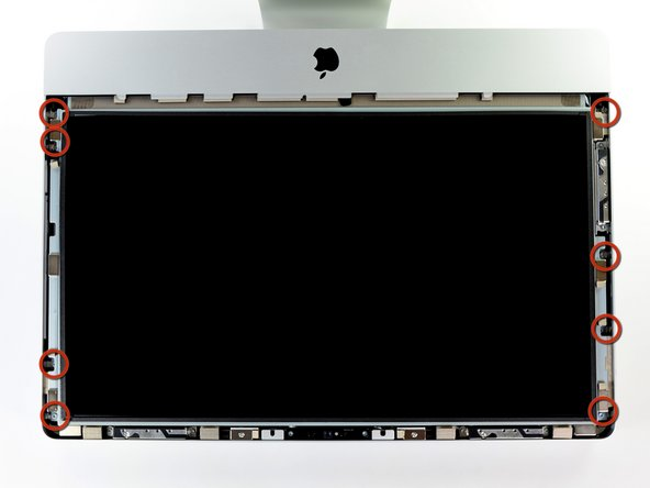 Image 1/3: Remove the eight 8 mm T10 Torx screws securing the display to the outer case.