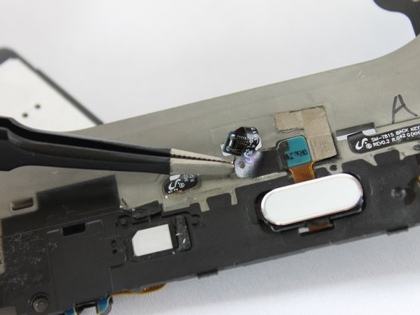 Carefully push the cable through the hole to the other side of the frame.