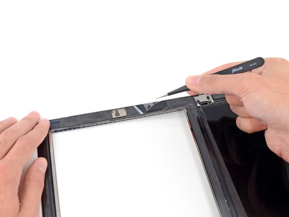 Image 1/1: Use a pair of tweezers to peel the clear backing up off each adhesive strip.