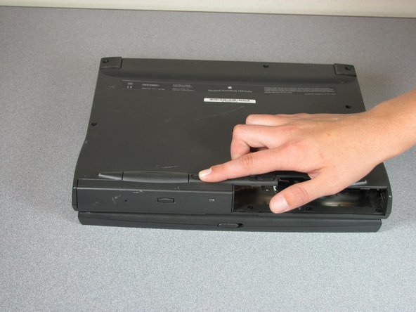 Slide the latch to the right to release the CD ROM drive.