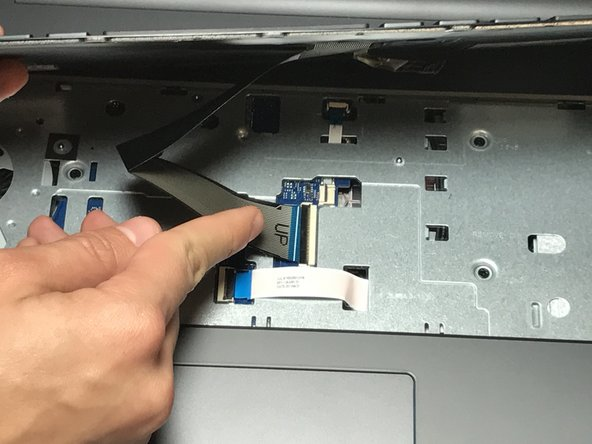 Gently release the ZIF tab that secures the keyboard ribbon cable to the laptop.