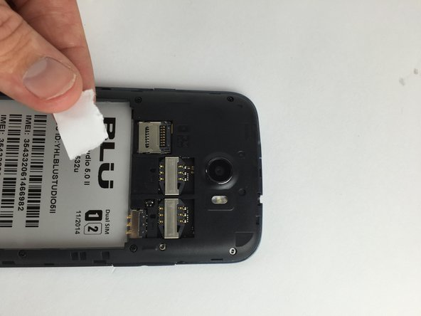 Image 2/2: Slide your finger downwards in order to remove the SIM Card from the slot.