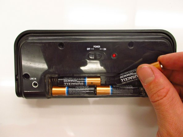 Remove the battery case cover and batteries.