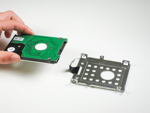 Remove the hard drive from the tray.